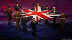 Servicemen and women from the Army, Royal Navy and Royal Air Force carry the Union Flag