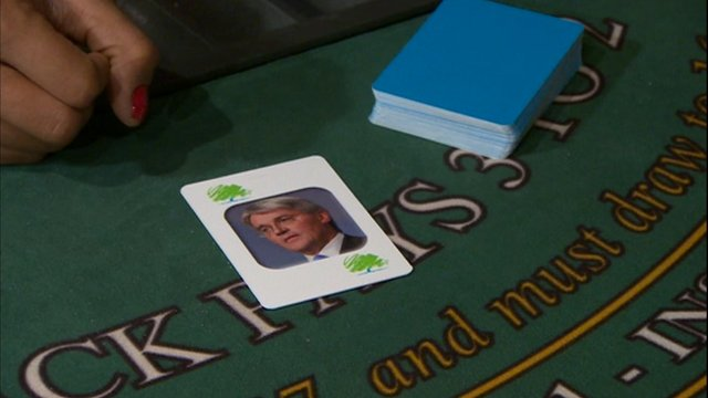 One card in pack shows face of International Development Secretary Andrew Mitchell