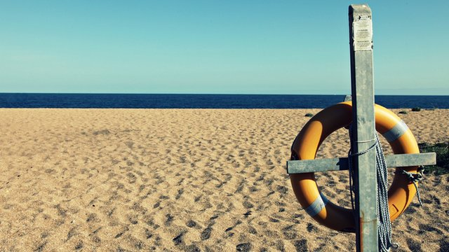 Life buoy on an empty beach