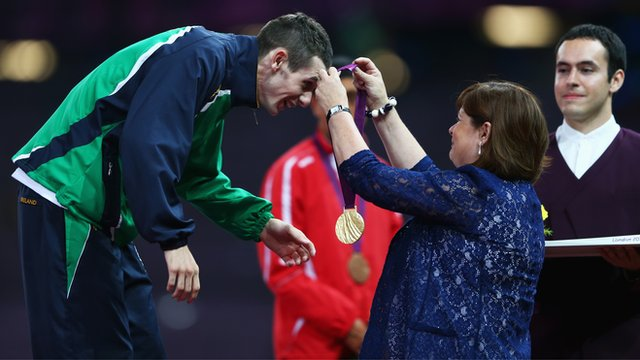 Michael McKillop's mother Catherine presents him with the T37 1500m gold medal in London