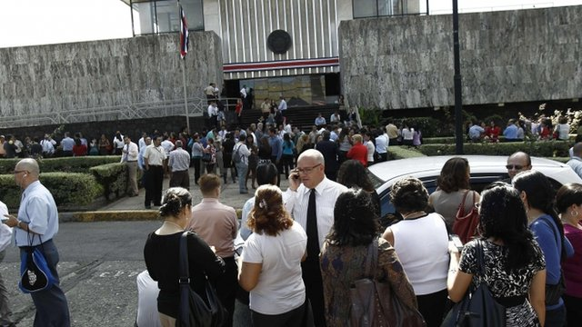 People stand outside court buildings in San Jose after evacuation