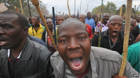 Workers marching in Marikana in South Africa's North West province on 5 September 2012
