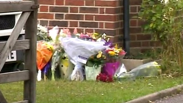 Flowers left outside house of victims