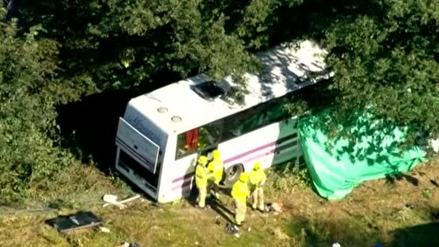 Crashed coach being inspected by police