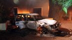 Wreckage of a car burned at the US consulate in Benghazi