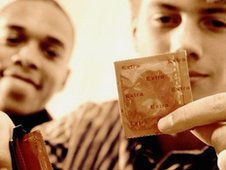 Boy holding condom