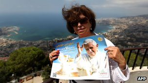 Lebanese woman holds a poster of Pope Benedict as she makes pilgrimage to Lady of Lebanon sanctuary in northern Lebanese Christian village of Harissa. 12 Sept 2012