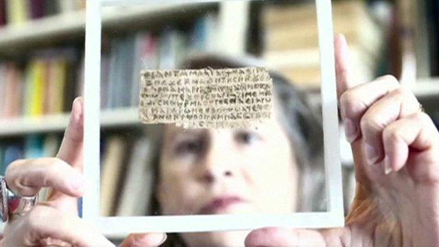 Harvard divinity professor Karen King holds the ancient scrap of papyrus