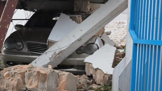 A car crushed under rubble