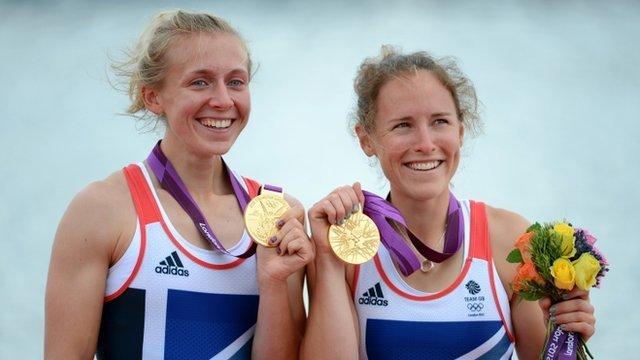 """Katherine Copeland (L) and Sophie Hosking of Great Britain celebrate with their gold medals during the medal ceremony for the Lightweight Women""""s Double Sculls"""