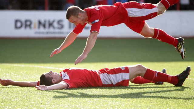 Cliftonville's Joe Gormley and Barry Holland celebrate the winning goal