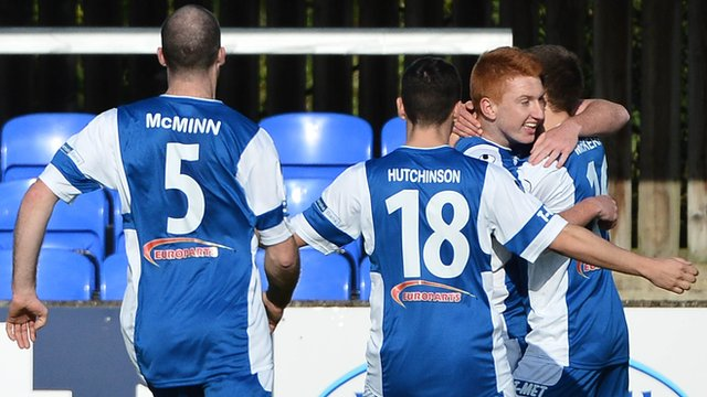 Dungannon Swifts players celebrate a 2-0 victory over Crusaders