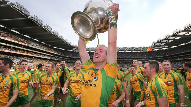 Neil Gallagher lifts the Sam Maguire cup at Croke Park