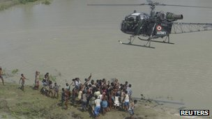 Flood-affected people receive supplies from the army