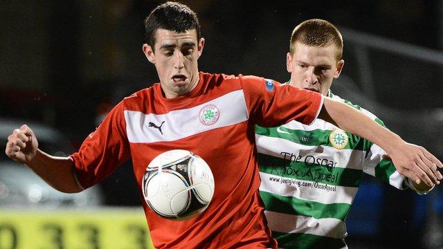 Cliftonville's Joe Gormley in action against Mark Burns of Donegal Celtic