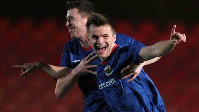 Linfield's Niall Quinn celebrates with team-mate Billy Joe Burns