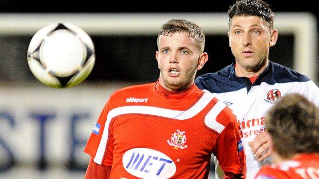 Portadown's Darren Murray in action against Crusaders Paul Leeman