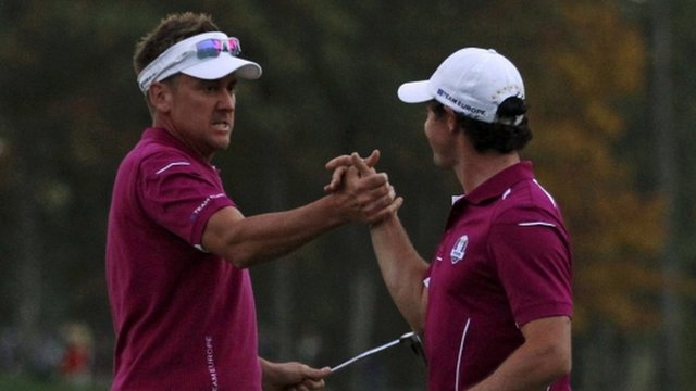 Ian Poulter and Rory McIlroy celebrate winning a crucial point for Europe
