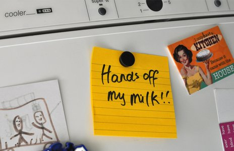 Note on fridge reading 'Hands off my milk!'