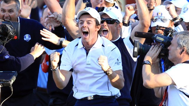 Rory McIlroy celebrates after Martin Kaymer's putt on the 18th