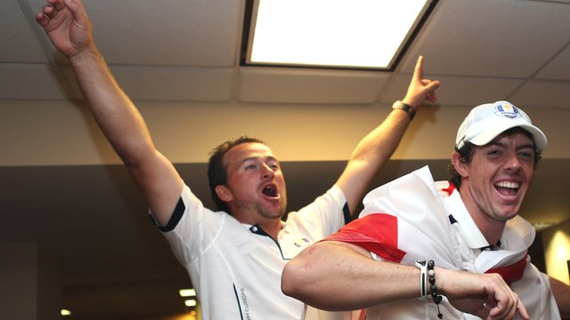 Graeme McDowell sings alongside Rory McIlroy in the lock room after the Ryder Cup triumph