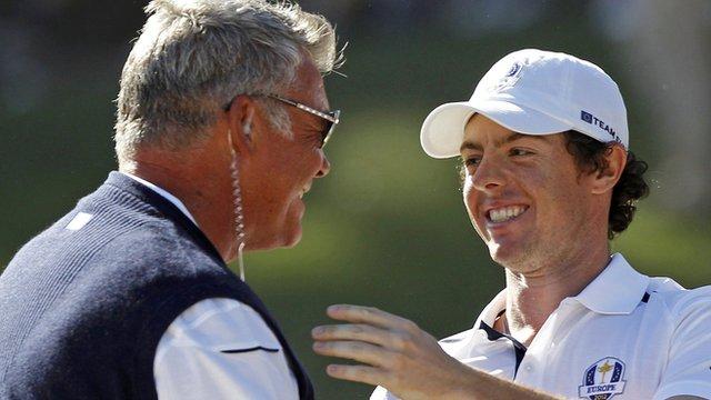 Darren Clarkes congratulates Rory McIlroy after his singles win over Keegan Bradley