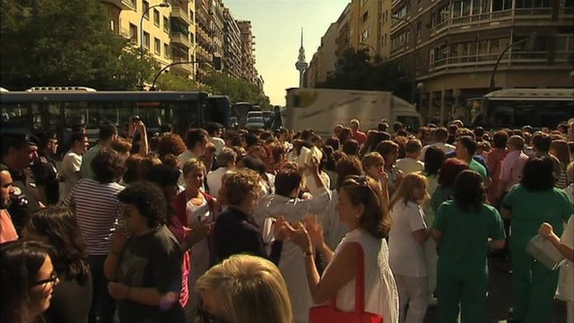 Public hospital workers in Spain protest by blocking a busy road in Madrid