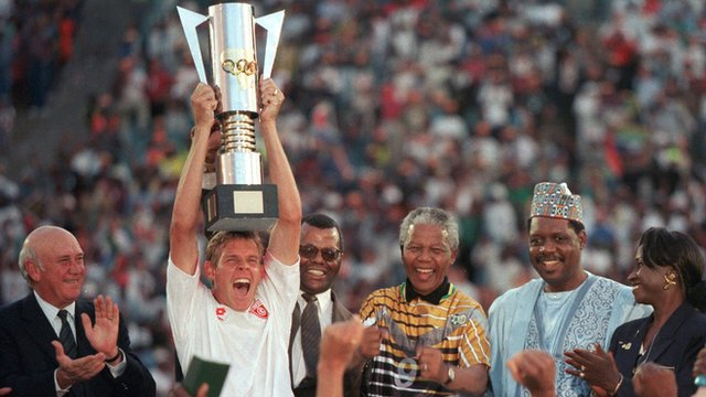 Neil Tovey lifts the 1996 Afcon trophy
