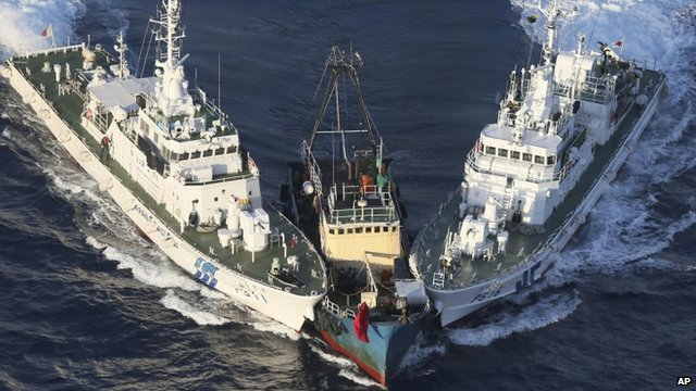 """The Boa Diao boat, centre, is surrounded by Japan Coast Guard""""s patrol boats after Hong Kong activists from Action Committee for Defending the Diaoyu Islands."""