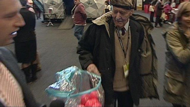 Tony Benn prepares to vote in mood box