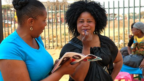 Nelli Siwe in Soweto with one of her customers