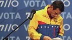 Venezuela's opposition presidential candidate Henrique Capriles leaves an election results news conference.