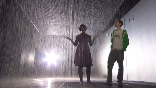 Brenda Emmanus is in the rain but not getting wet