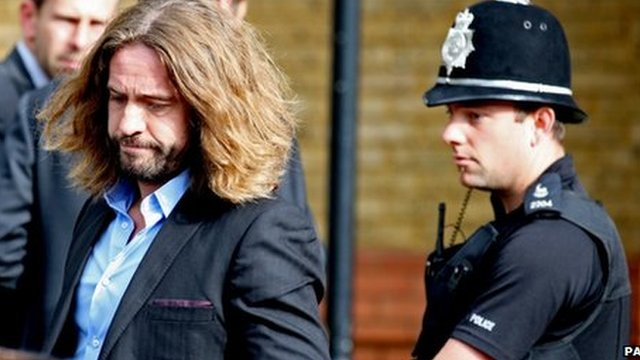 Justin Lee Collins leaves St Albans Crown Court after being found guilty of harassment