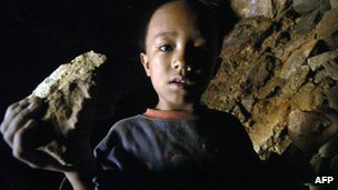 Boy holding piece of gold ore