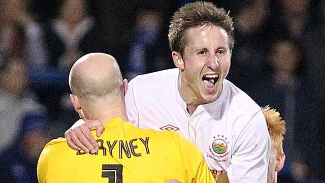 Linfield's Alan Blayney celebrates with goal scorer Michael Carvill