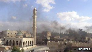 Smoke rises over Maaret al-Numan in Idlib, Syria (8 Oct 2012)