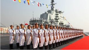 """Naval honour guards stand as they wait for a review on China""""s aircraft carrier """"Liaoning"""" in Dalian, Liaoning province, September 2012"""