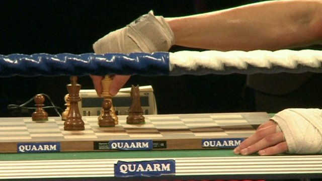 The hands of a chessboxer playing cess