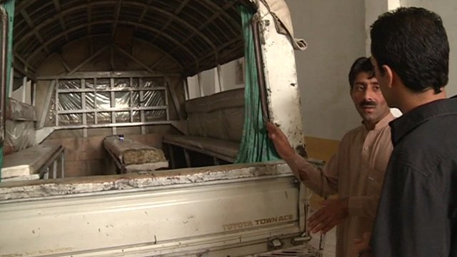 The BBC's Aleem Maqbool is shown the truck Malala was travelling in when she was shot in Mingora, Pakistan