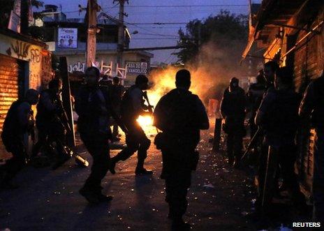 Brazilian police take up position in the Jacarezinho slum in Rio de Janeiro, 14 October