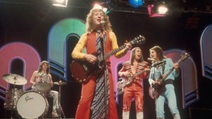 Slade (Dave Hill is central guitarist)