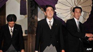 Shinzo Abe (C), leaving the controversial Yasukuni Shrine in Tokyo, 17 October 2012