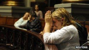 Anti-abortion campaigner praying in the Uruguayan Congress