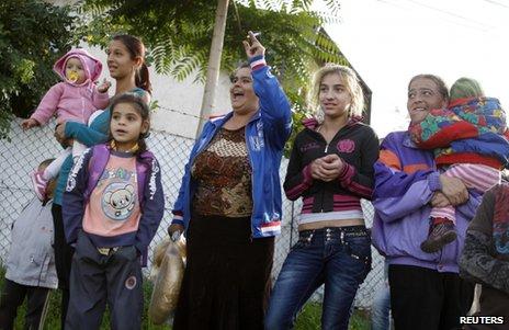 Women cheer a Roma (Gypsy) rally in Miskolc, 17 October