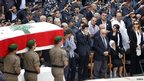 Members of the Internal Security Forces carry the coffin Wissam al-Hassan past his family and officers at ISF headquarters Ashrafiyeh Beirut October 21, 2012