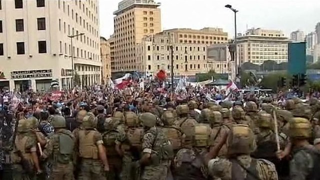 Lebanese security forces facing down protesters in Beirut
