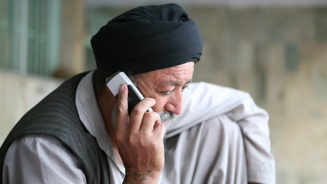 Man uses mobile phone in Kabul
