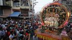 Artists sit on a chariot dressed as Hindu deities (from left) Lakshman, Ram and Sita during a Dussehra procession in Allahabad on 21 October