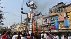 Indian traders burn an effigy representing a Foreign Direct Investment (FDI) Ravana in Delhi on 23 October 2012